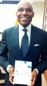 Mayor A. C. Wharton, Jr. of Memphis, Tennessee receives the ASEAN Matters for America booklet.